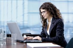 alert woman at desk